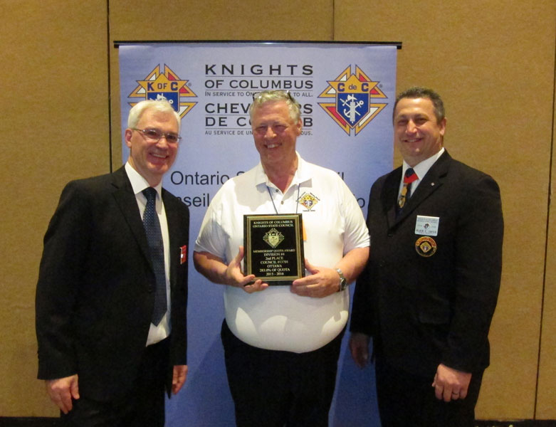 New member SK Douglas Randall, DD for district 92, accepts a State award on behalf of the council.